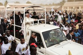 Pope Francis is calling for peace between Christians, Muslims in Central African Republic's war-torn PK5
